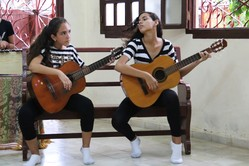 Spanish guitar is one of the musical genres taught in the youth music program at the Toyos Mission.
