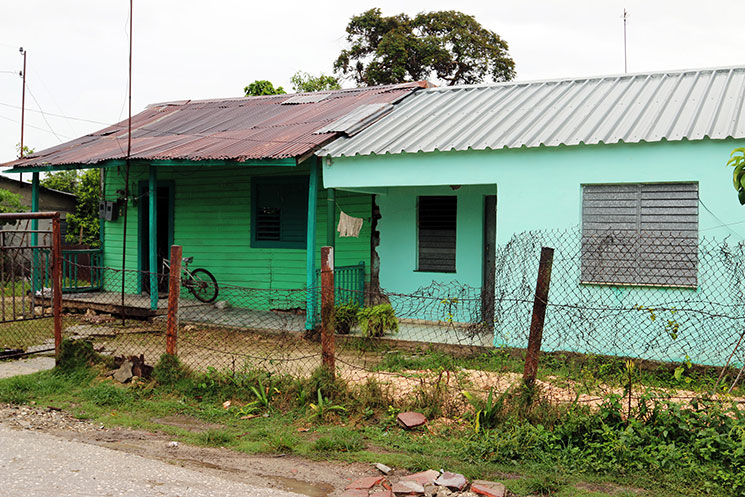 The modest home of Abel Perviez (green house on the left) serves as the sanctuary for the Jatibonico Mission.