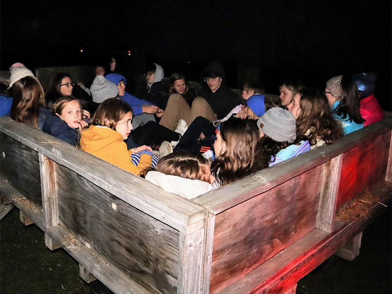Youth pile into a wagon for a hayride at Cedar Ridge Camp outside of Louisville, Ky. Photo by Andrew Hartmans.