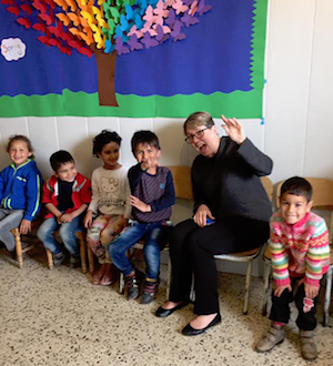 Image of Co-Moderator Jan Edmiston with Children While Visiting Syria in March 2017