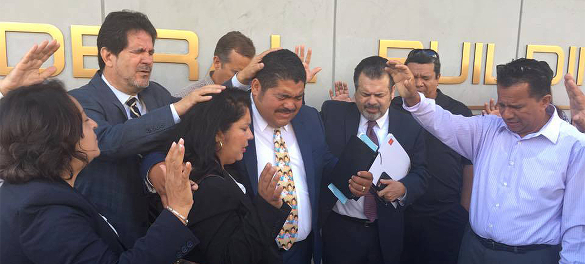 Praying Pastor Noe into his check-in with ICE before he was taken away in handcuffs