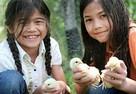 Girls with chickens