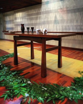 """This table was built for crucifiers."" Photo by Chip Hardwick of the Communion Table at the Presbyterian Center."